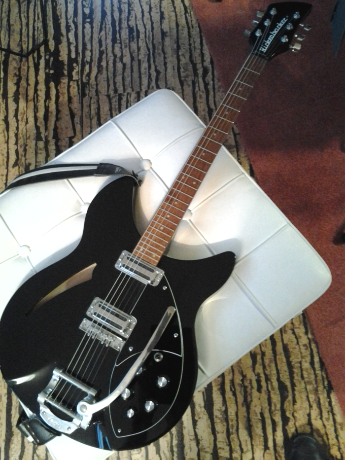 This first change I made to this guitar was to have a black/white/black set of guards cut to replace the original white set.
